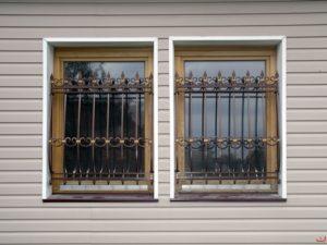 Кованые решетки на окна фото №79