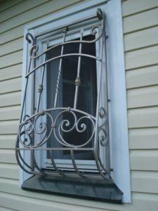 Кованые решетки на окна фото №54