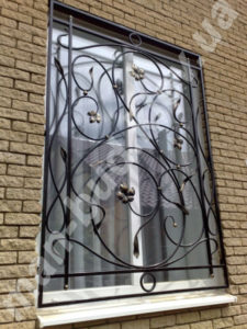 Кованые решетки на окна фото №18