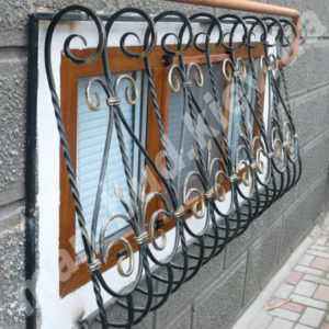 Кованые решетки на окна фото №30