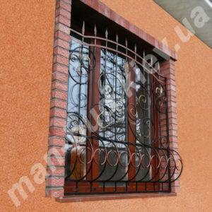 Кованые решетки на окна фото №29